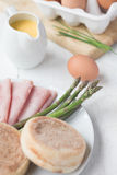 Eggs Benedict with ham & asparagus Stock Photo