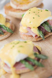 Eggs Benedict with ham & asparagus Stock Images