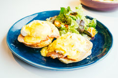 Eggs benedict with ham and sauce on top Stock Image