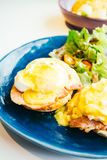 Eggs benedict with ham and sauce on top Stock Photos