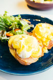 Eggs benedict with ham and sauce on top Stock Photography
