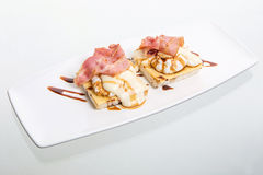 Eggs Benedict with ham on toast with cheese. Isolated on white Stock Photos