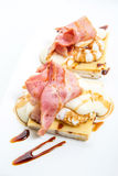 Eggs Benedict with ham on toast with cheese. Isolated on white Stock Images