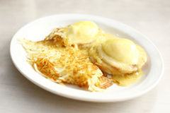 Eggs benedict and hash brown potatoes Stock Image