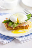Eggs Benedict with hollandaise sauce on toast with  bacon and as Royalty Free Stock Photo