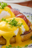 Eggs benedict, prosciutto with hollandaise Royalty Free Stock Photo