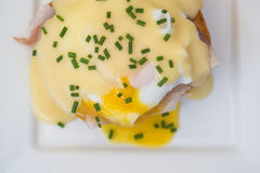 Eggs Benedict toasted English muffins ham poached eggs and holla Stock Photography