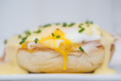 Eggs Benedict toasted English muffins ham poached eggs and holla Royalty Free Stock Photos