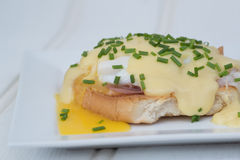 Eggs Benedict toasted English muffins ham poached eggs and holla Stock Images