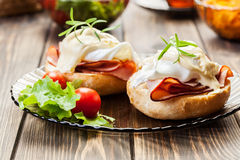 Eggs Benedict on toasted muffins with ham Stock Image