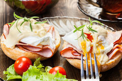 Eggs Benedict on toasted muffins with ham Royalty Free Stock Photography