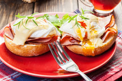 Eggs Benedict on toasted muffins with ham Stock Images