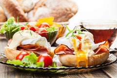 Eggs Benedict on toasted muffins with ham Royalty Free Stock Images