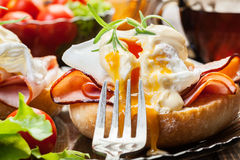 Eggs Benedict on toasted muffins with ham Stock Photos