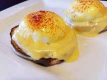 Eggs Benedict on a White Plate royalty free stock photo