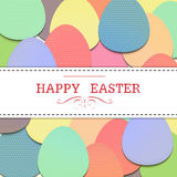 Eggs bg. Text  happy easter on white label that on background of colorful eggs Stock Images