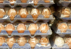 Eggs in big packages Royalty Free Stock Photography
