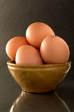 Eggs on black Royalty Free Stock Images