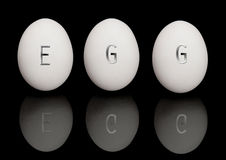 Eggs on black Royalty Free Stock Photos