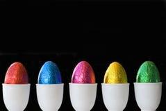 Eggs black background Stock Photos