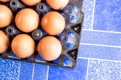 Eggs. In the black basket Royalty Free Stock Photography