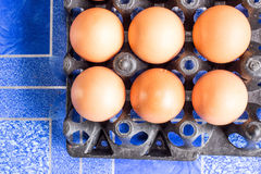 Eggs. In the black basket Royalty Free Stock Photos