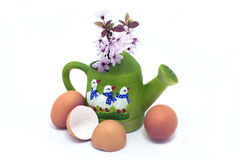 Eggs and blossom in green watering can with geese. Eggs and pink blossom in green watering can with geese Stock Image