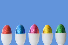 Easter Eggs in a row, blue background, copy space Stock Photo