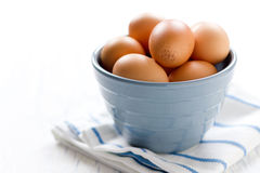 Eggs in blue bowl Stock Images