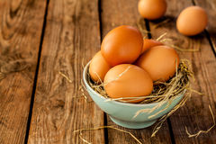 Eggs in a blue bowl on rustic vintage wood Stock Image