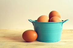 Eggs in blue metal bowl Stock Photography