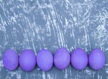 Colorfu eggs on stone background. Eggs on blue stone background. Happy Easter Royalty Free Stock Photo