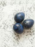 Colorfu eggs on stone background. Eggs on blue stone background. Happy Easter Stock Photos