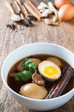 Eggs boiled in the gravy with spices on wooden background.Thai cuisine (Kai pa lo) Royalty Free Stock Images