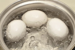 Eggs boiling Royalty Free Stock Photos