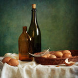 Eggs and bottles Royalty Free Stock Photography