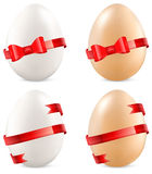 Eggs with bow Royalty Free Stock Images