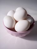 Eggs in Bowl. Eggs in Pink bowl stock images