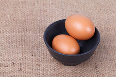 Eggs in a bowl on brown sack Royalty Free Stock Image