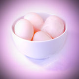 Eggs in bowl with feathers Royalty Free Stock Images