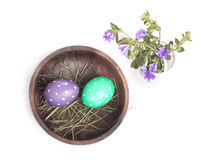 Eggs in a bowl and flowers Royalty Free Stock Photos