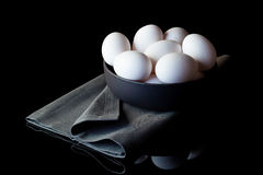 Eggs in a bowl on grey napkin from side Stock Image