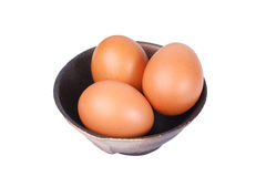 Eggs in a bowl isolate on white Stock Photos