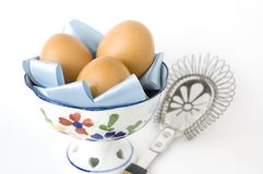 Eggs in bowl with kitchenware Stock Photos