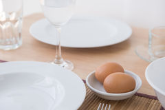 Eggs on bowl Stock Photos