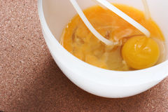 Eggs Bowl and Whisk. Eggs in bowl with whisk Stock Photos