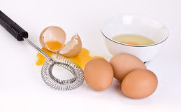 Eggs bowl and wisk Stock Photo