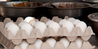 Eggs and bowls with a filling for cooking. Packing eggs and a bowl with a filling for cooking a large amount of food stock images