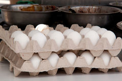 Eggs and bowls with a filling for cooking. Packing eggs and a bowl with a filling for cooking a large amount of food stock photography