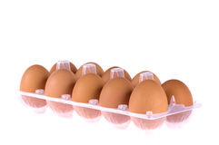 Eggs in box. Open eggbox isolated on white background Stock Photo